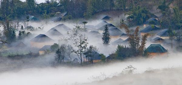 Maisons en torchis dans la région de Y Ty, Lao Cai
