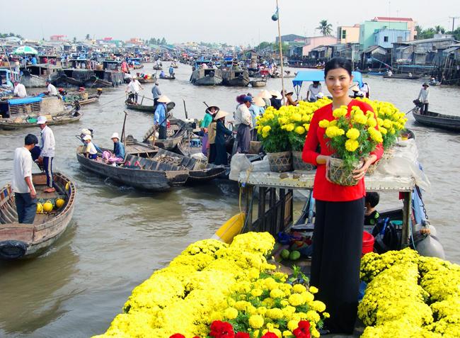 Une vendeuse de fleurs Cai Be